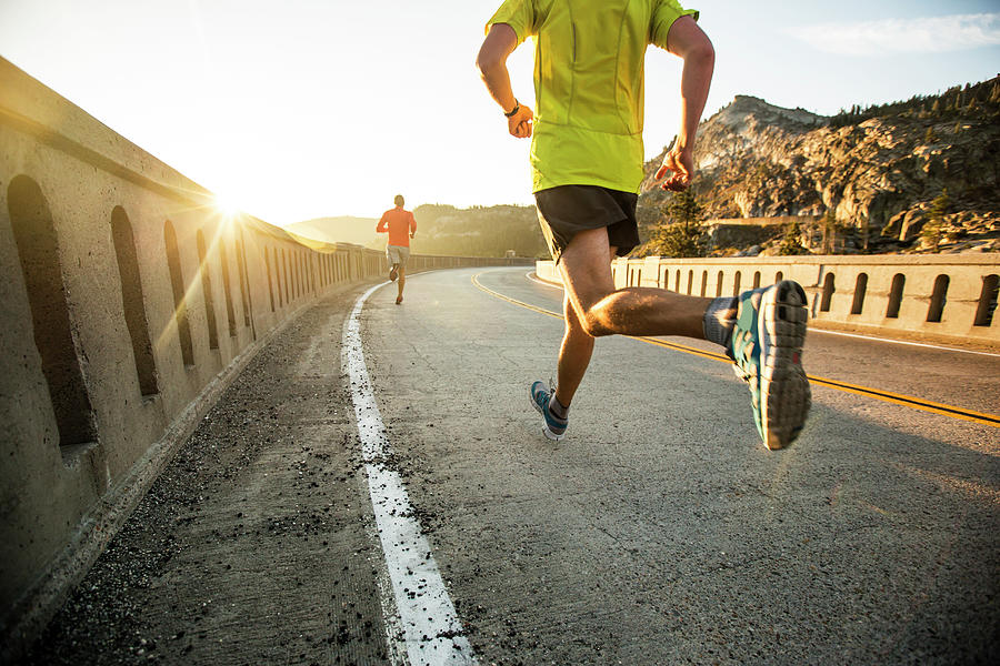 Two Men On An Early Morning Run Photograph by Jordan Siemens