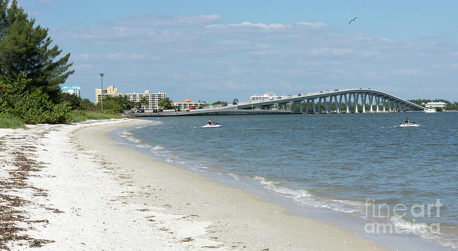 Florida Photograph - Two Men Set Out On Jet Skis From A Sanibel Island Causeway Islan by William Kuta