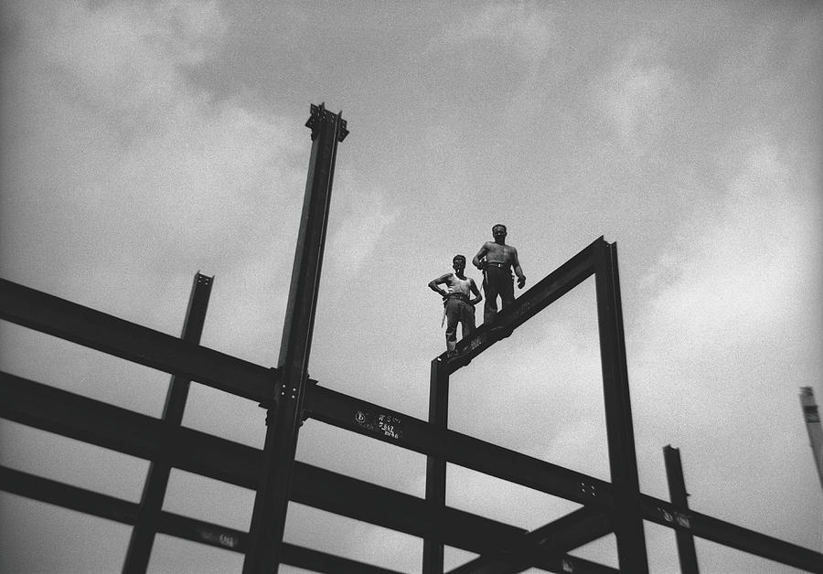 Two Men Walking On Iron Construction Photograph by George Marks