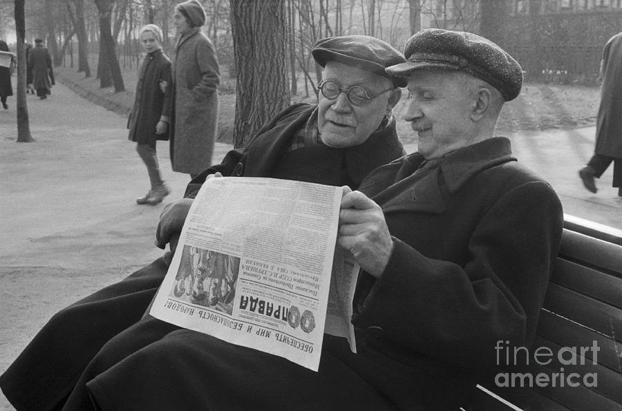 Two Russians Reading Newspaper Photograph by Bettmann