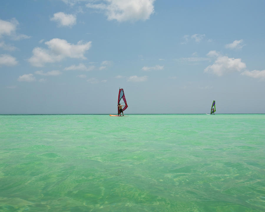 Two Windsurfers In Caribbean Waters Photograph by Ashok Sinha