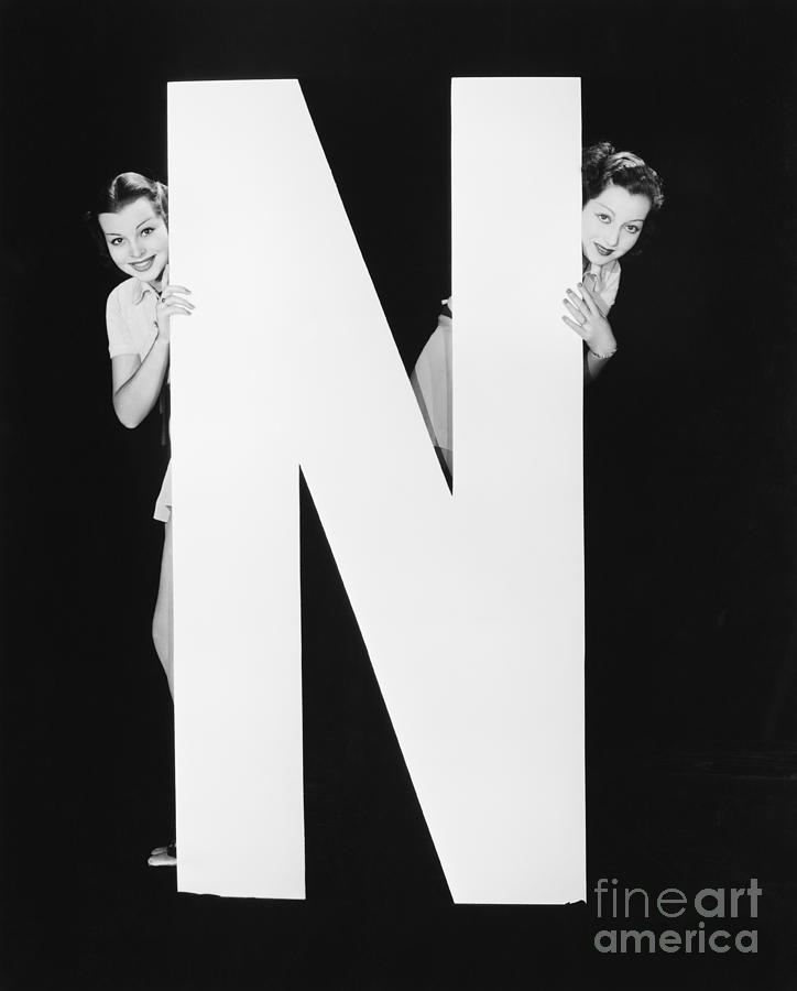 Big Photograph - Two Women Hiding Behind Huge Letter N by Everett Collection