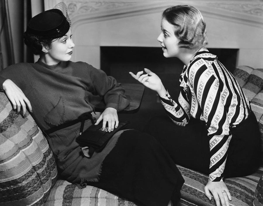 Two Women In Casual Conversation Photograph by George Marks