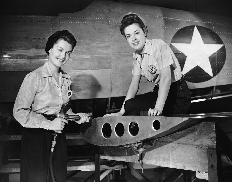 Two Women Working On Airplane Photograph by George Marks