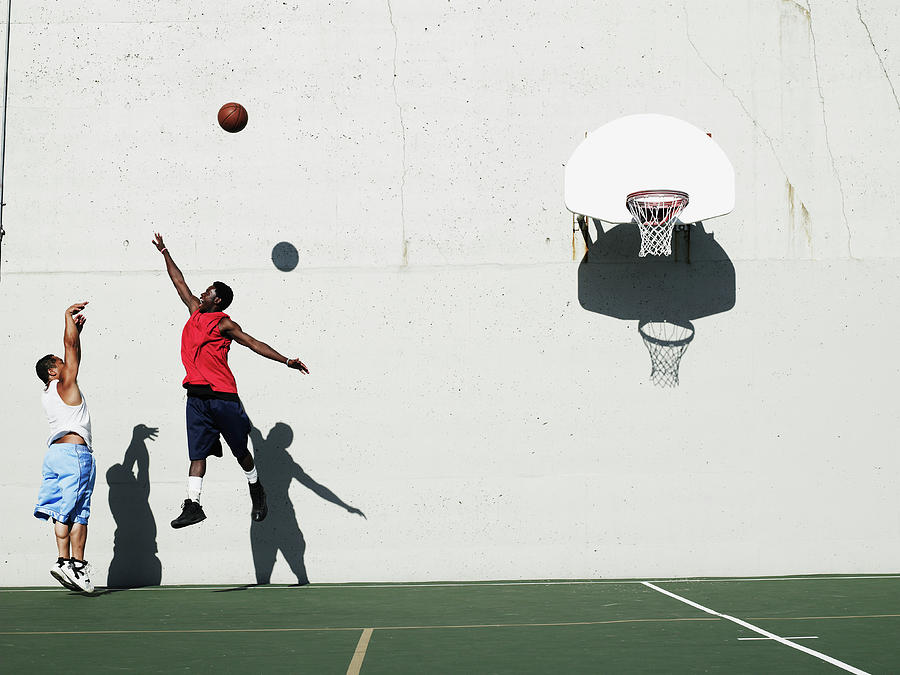 Two Young Men Playing Basketball Photograph by Thomas Barwick