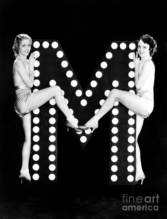 Two People Photograph - Two Young Women Posing With The Letter M by Everett Collection