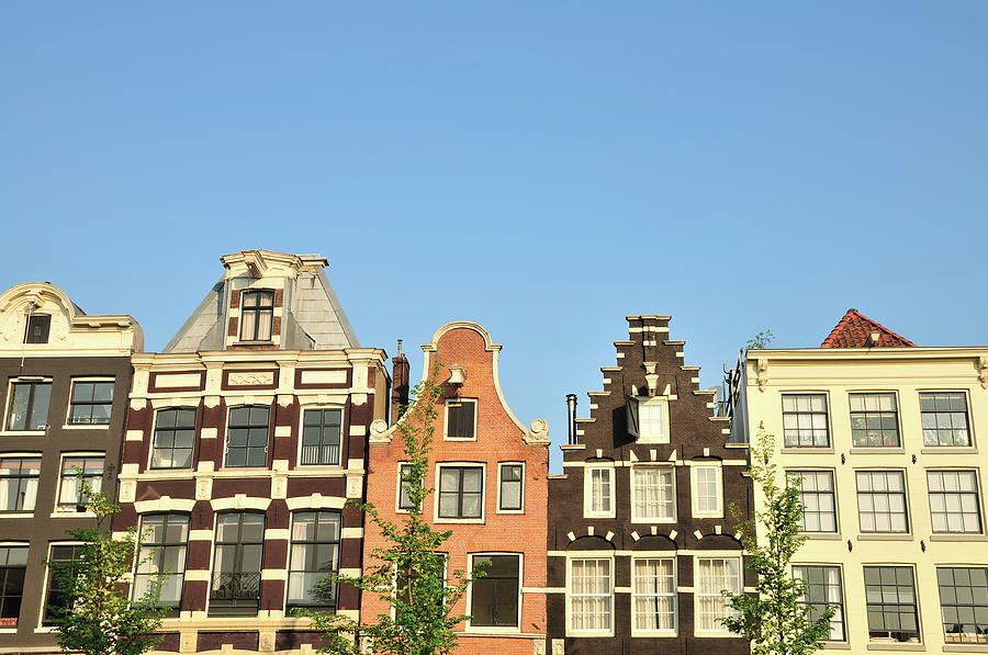 Typical Canal Houses, Amsterdam, The Photograph by Gorazdbertalanic