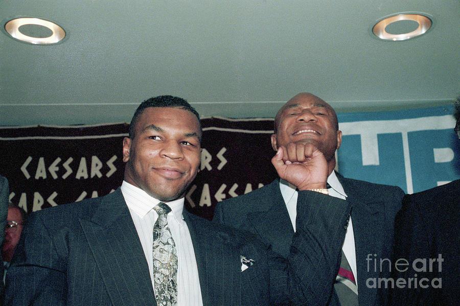 Tyson Pretend Punching George Foreman Photograph by Bettmann
