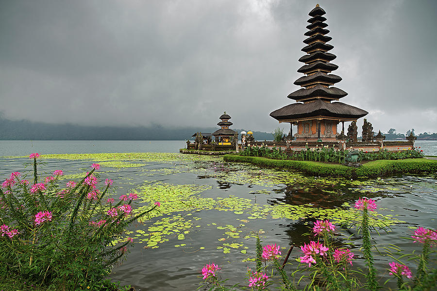Ulun Danu Temple With Flowers And Water Photograph by Andrew Tb Tan