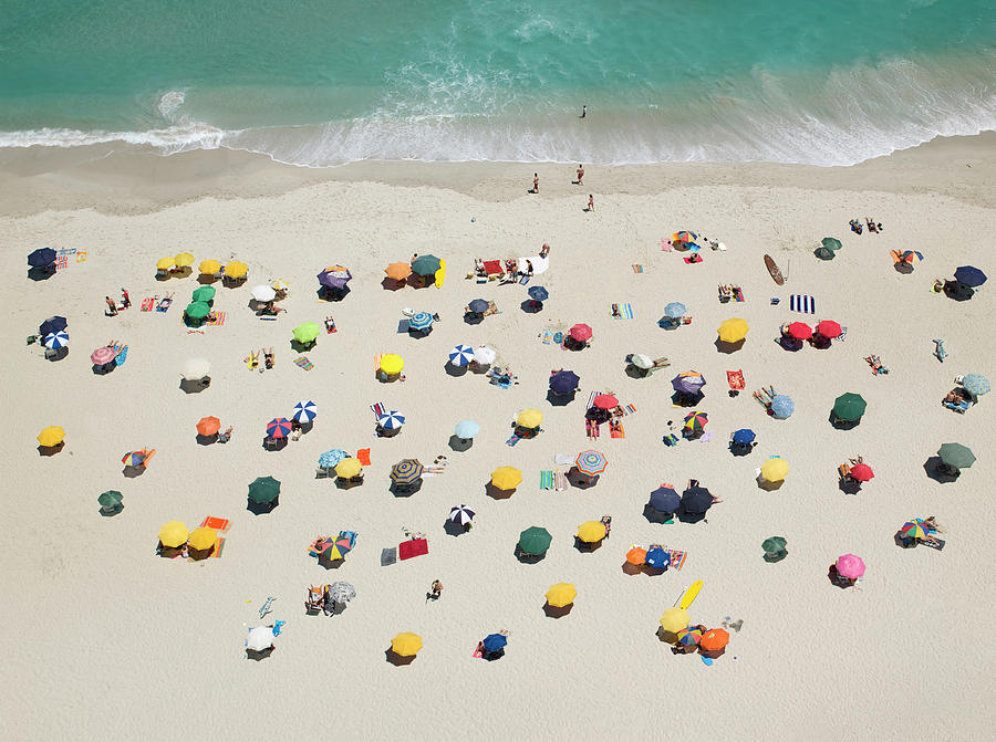Umbrella Pattern On Beach Photograph by Roger Wright