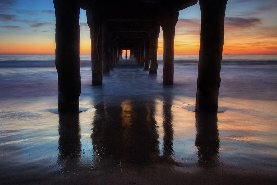 Under Manhattan Beach Pier by Andy Konieczny