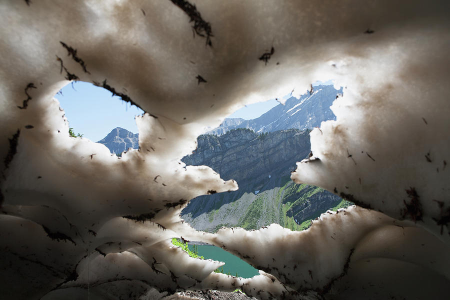 Underneath A Melting Snow Pack With Photograph by Michael Interisano / Design Pics