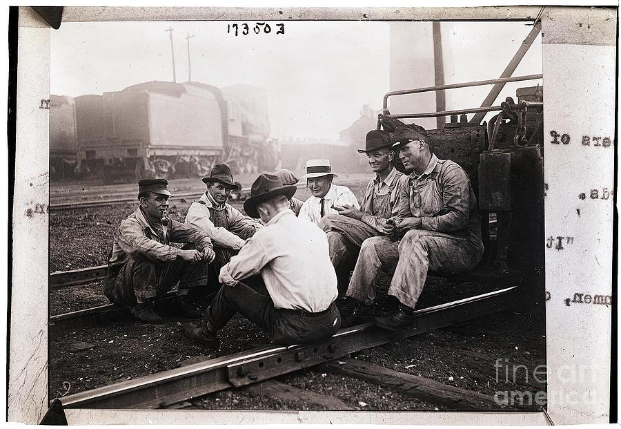 Union Men Talking In Train Yard Photograph by Bettmann