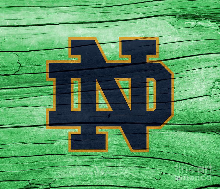 University of Notre Dame Fighting Irish Logo On Green Rustic Wood by John Stephens
