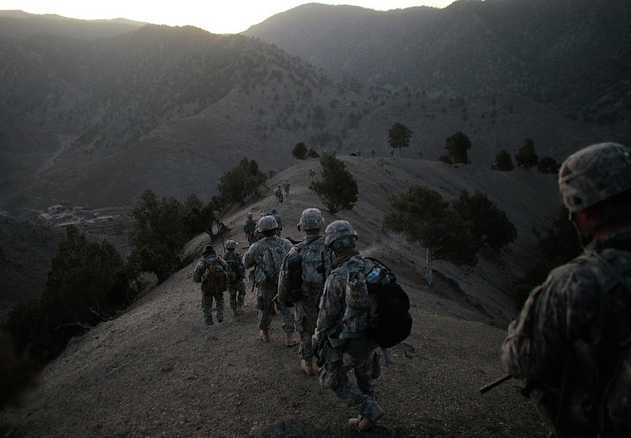 Us Army Searches For Militants In Photograph by Chris Hondros