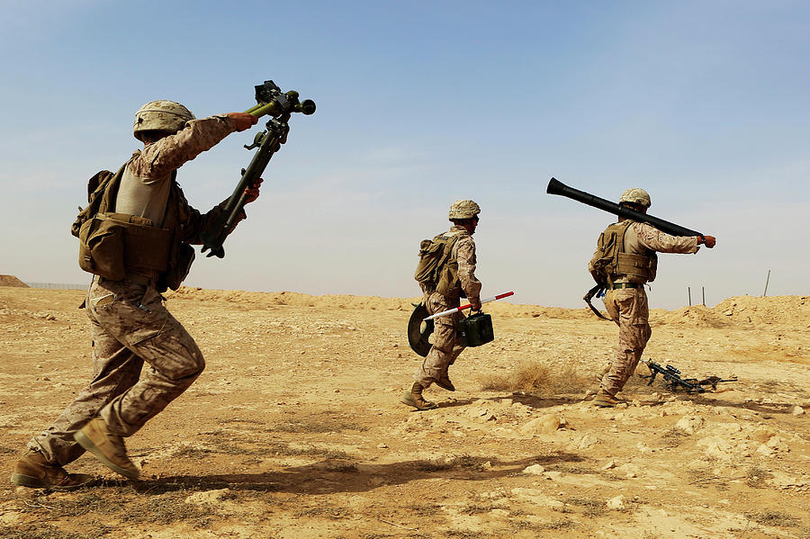 Al Asad Air Base Photograph - U.s. Marines Rush With Their Weapons by Stocktrek Images