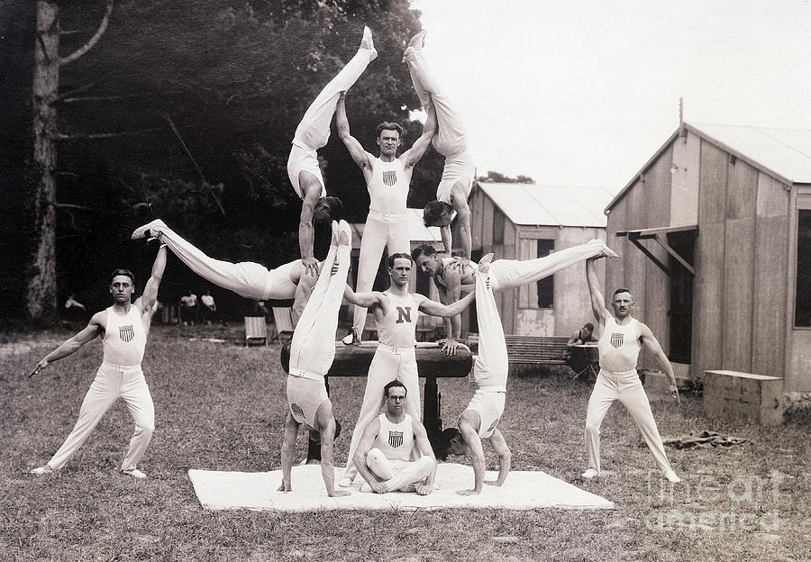 Us Olympic Gymnasts Pose In Pyramid Photograph by Bettmann