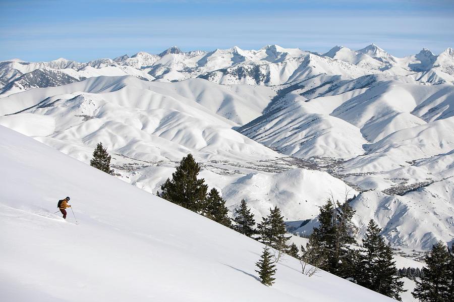 Usa, Idaho, Sun Valley, Man Downhill Photograph by Karl Weatherly