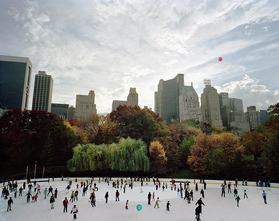 Usa, New York City, People Ice Skating Photograph by Carl Lyttle