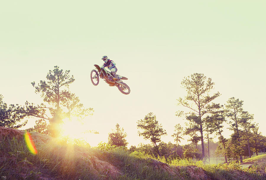 Usa, Texas, Austin, Dirt Bike Jumping Photograph by Tetra Images - King Lawrence