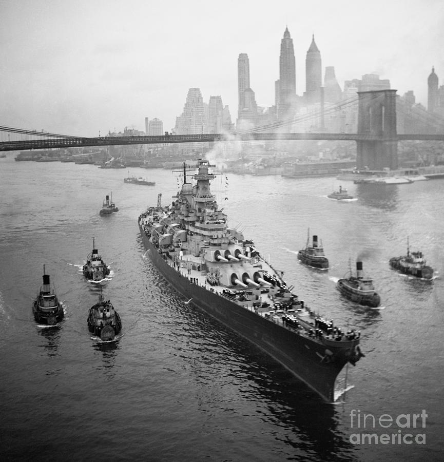 Uss Missouri Sailing Under Bridge Photograph by Bettmann