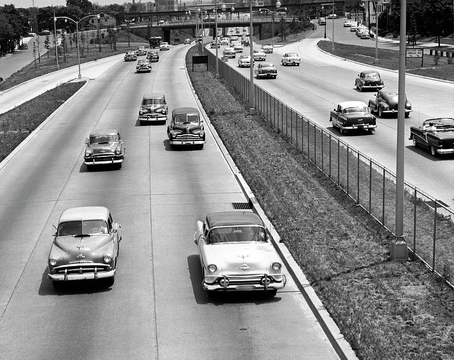 Land Vehicle Photograph - Various American Autos On Highway by George Marks