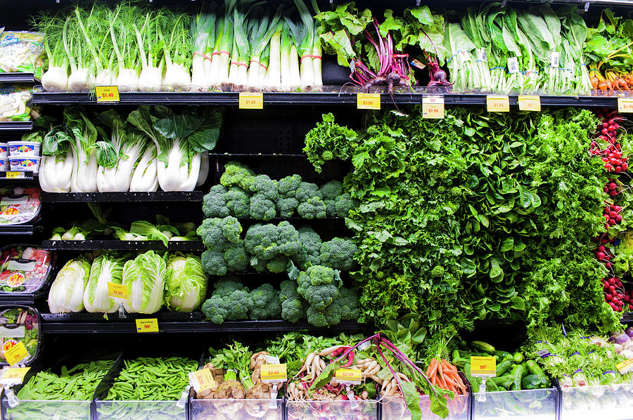 Vegetables On Display In A Supermarket Photograph by Liam Bailey
