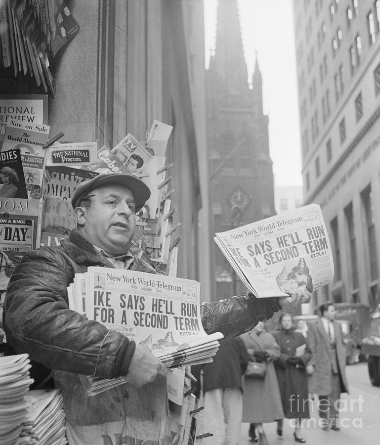 Vendor Holding Paper With Headline Photograph by Bettmann