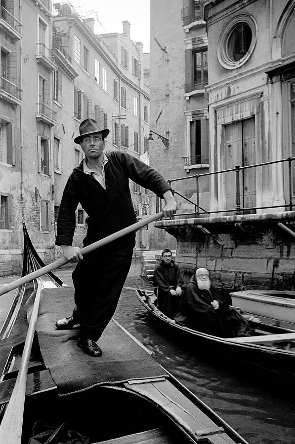 Venetian Gondolier Navigating Canal Photograph by Alfred Eisenstaedt