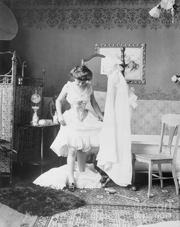 Victorian Woman Undressing In The Bath Photograph by Bettmann