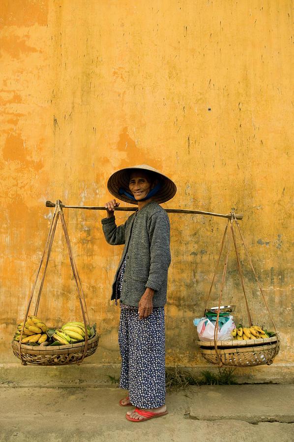 Vietnamese Woman Copy Space Yellow Wall Photograph by Laughingmango