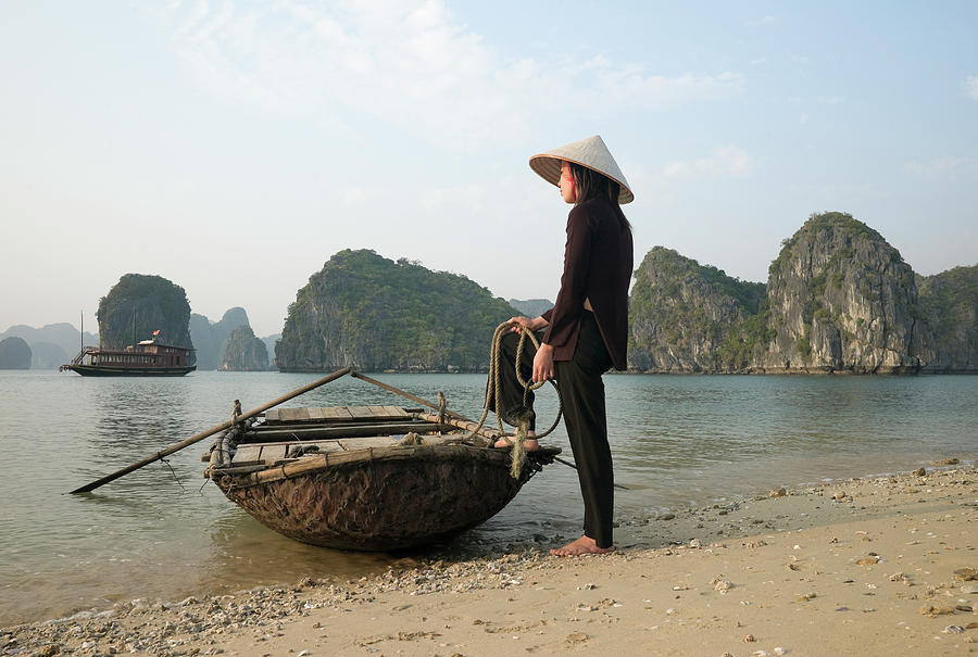 Vietnam,halong Bay,woman With Boat Photograph by Martin Puddy