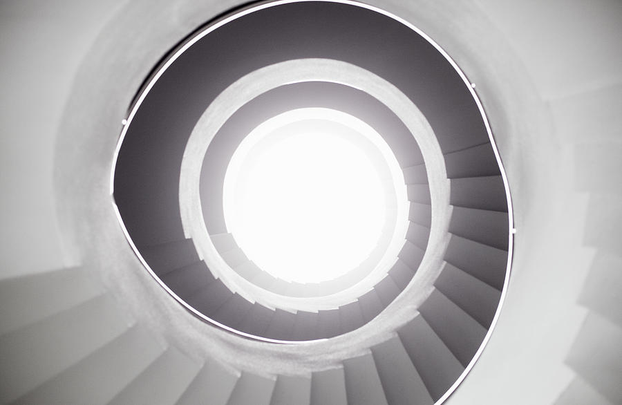 View From Bottom Of Spiral Staircase Photograph by Tim Robberts
