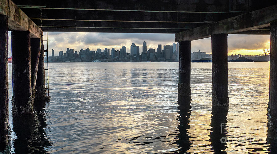 Dawn Photograph - View Of Downtown Seattle At Sunset From Under A Pier by PorqueNo Studios