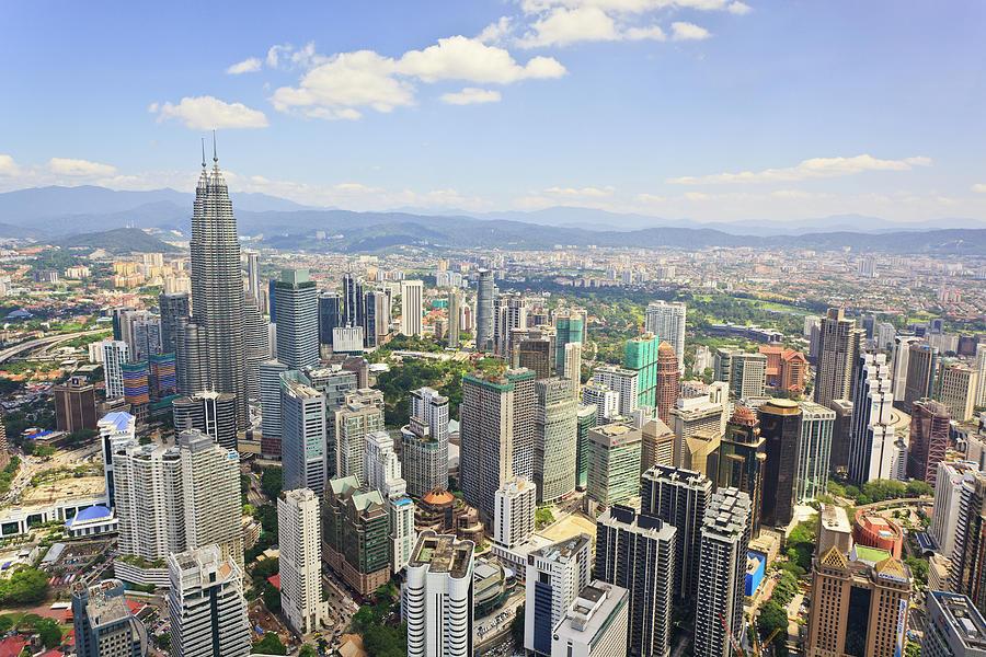 View Of The Kuala Lumpur Skyline Photograph by Tom Bonaventure