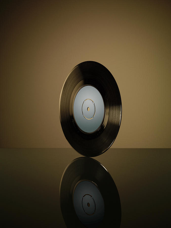 Vinyl Record On Reflective Surface Photograph by Jonathan Knowles