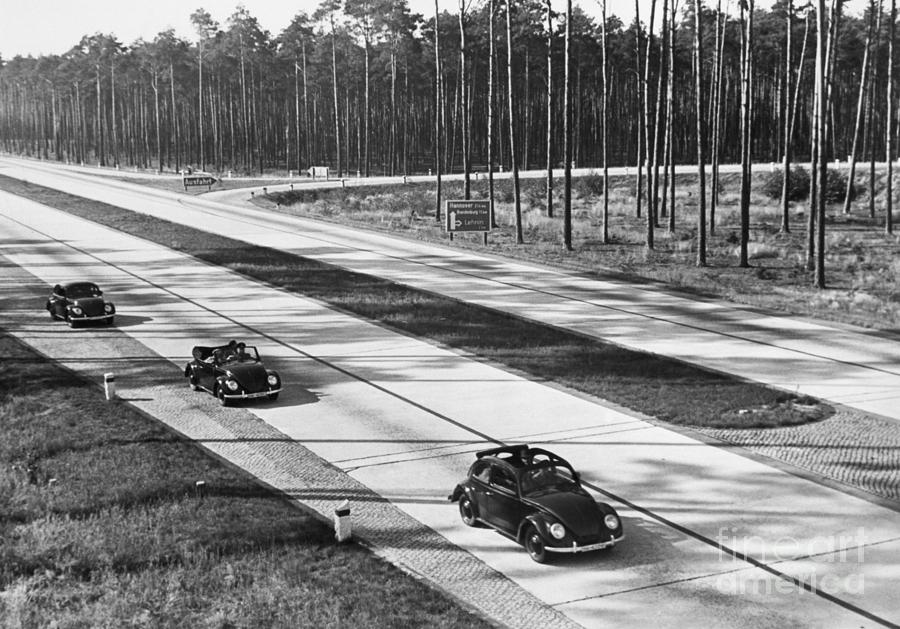 Volkswagen Cars On Road Photograph by Bettmann