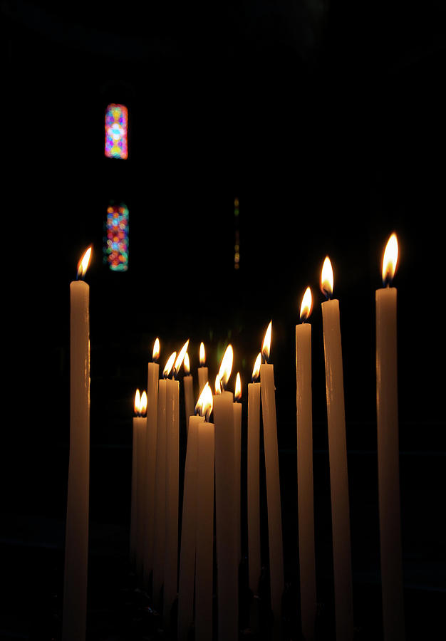 Votive Candles Burning In A Church In Photograph by Gregory Adams