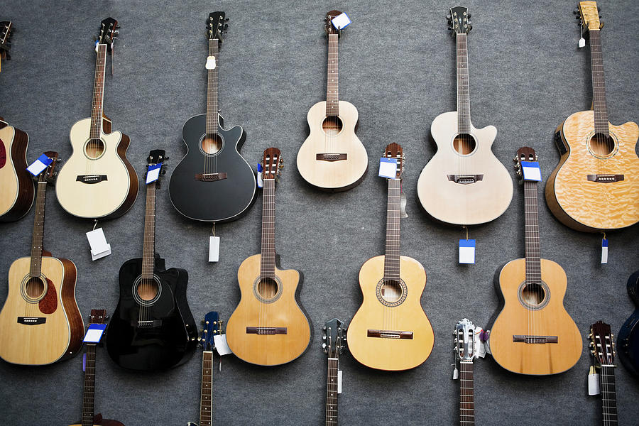 Wall Of Guitars Photograph by Rapideye