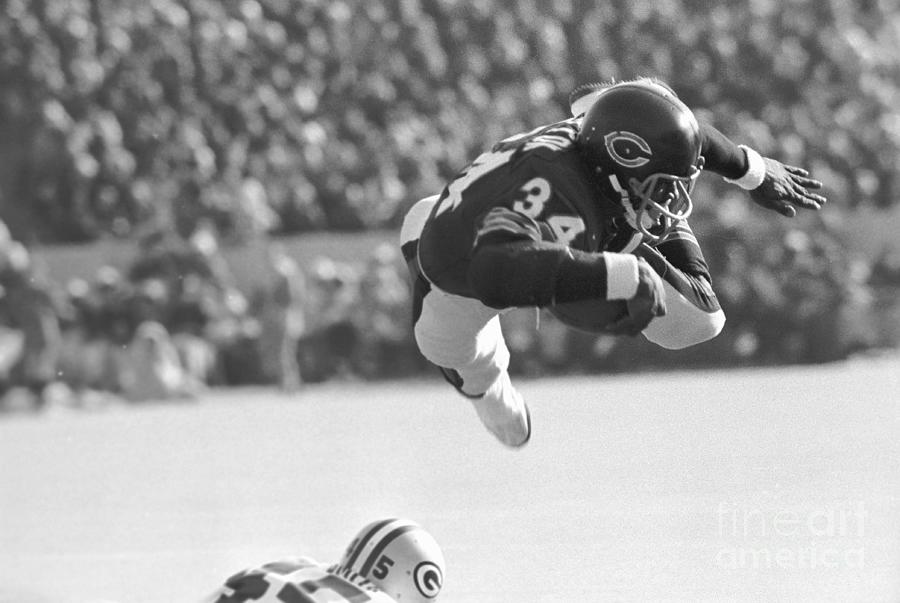 Walter Payton In Mid-leap With Football Photograph by Bettmann
