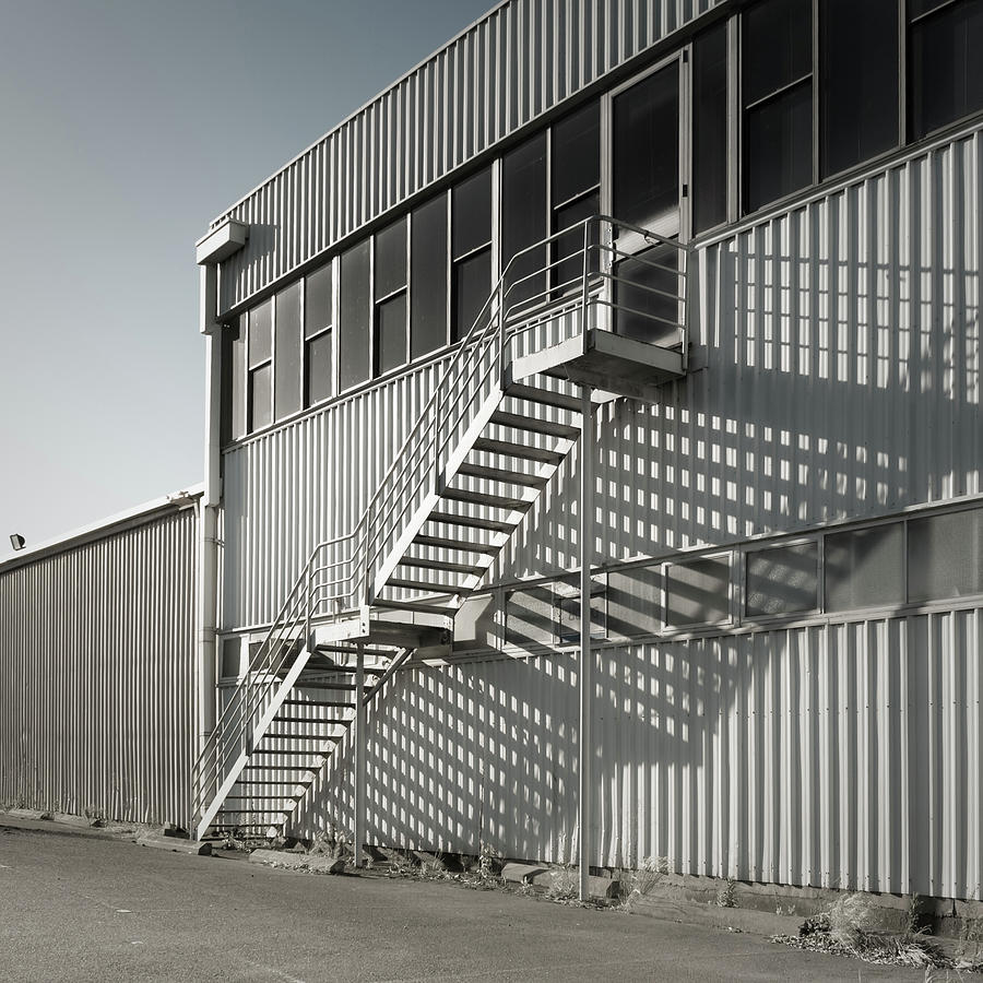 Warehouse And Fire Escape Photograph by John Abbate