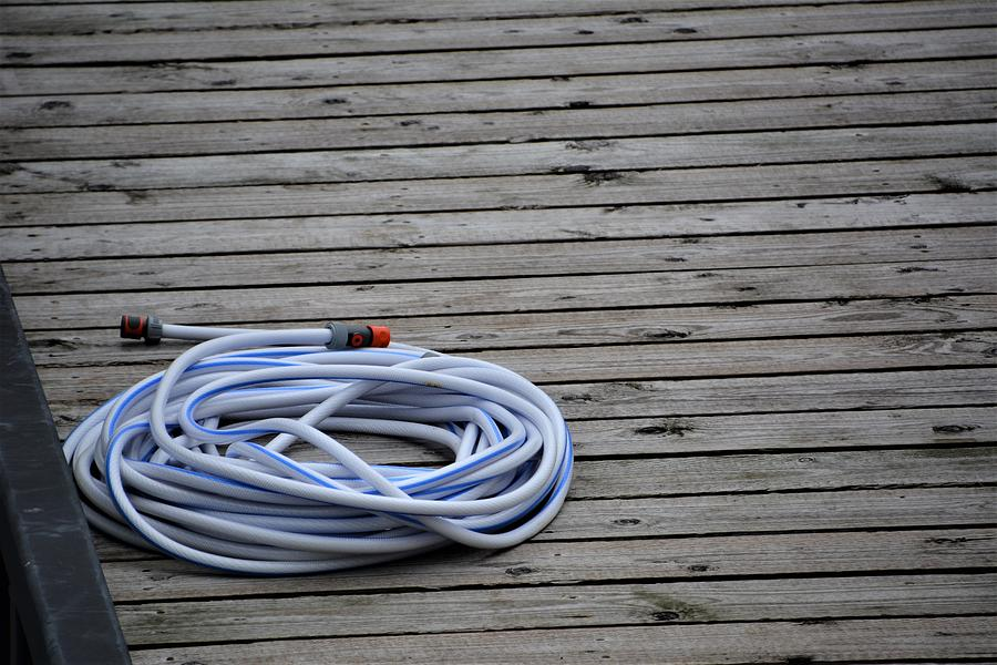 Hose Photograph - Water Hose On Dock by Norman Burnham