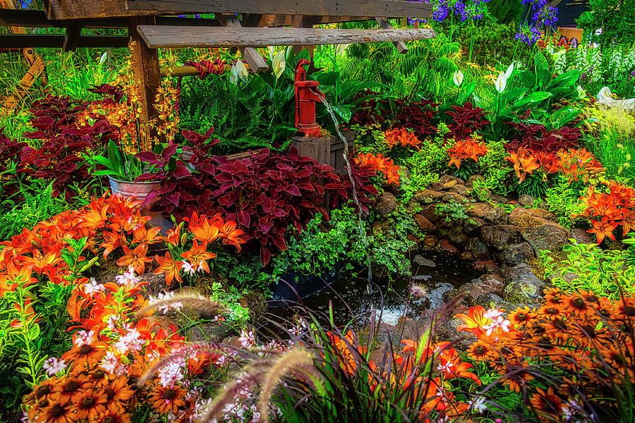 Water Pump In Lush Garden by Garry Gay