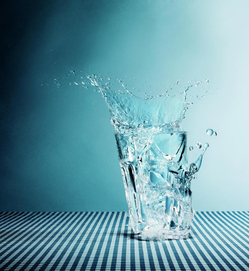 Water Splashing From Broken Glass Photograph by Henrik Sorensen