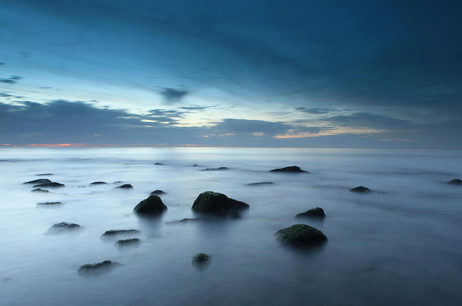 Waves Breaking On The Rocks Of A Photograph by Gaps