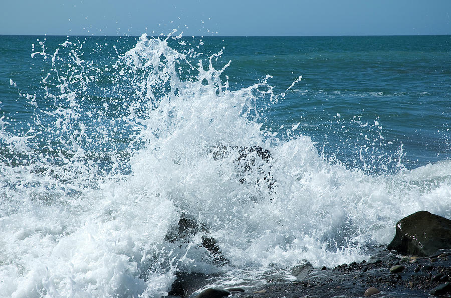 Waves Splashing Up High On Rocks On A Photograph by Clagge