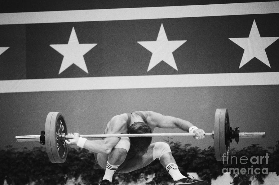 Weightlifter Losing Control Of Weights Photograph by Bettmann