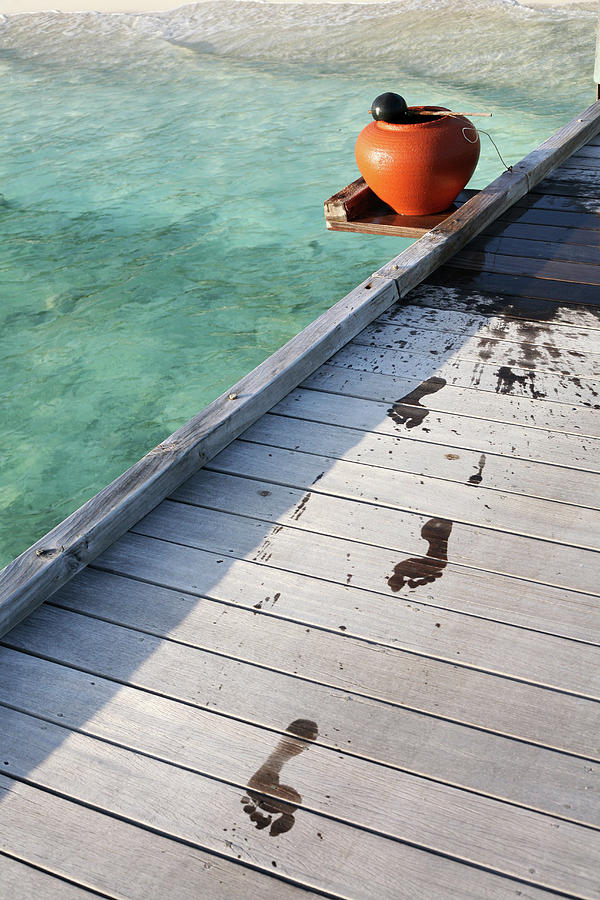 Wet Footprints On Dock Photograph by Win-initiative