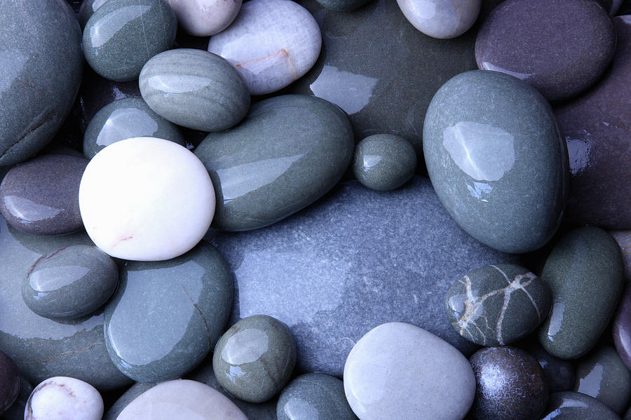 Wet Granite Pebbles On Beach Photograph by Rosemary Calvert