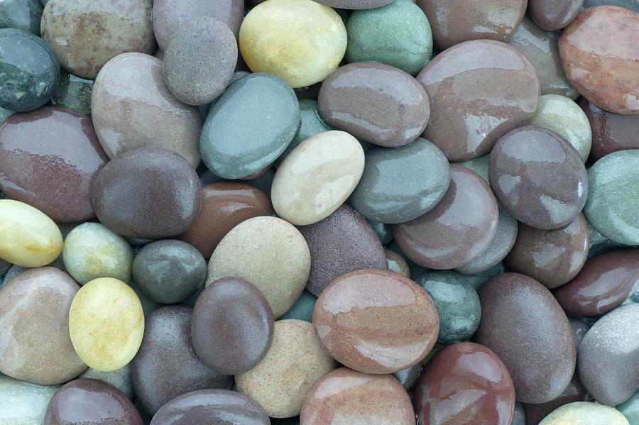 Wet Shiny Granite Pebbles On Beach Photograph by Rosemary Calvert